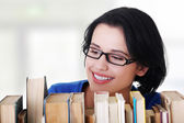 Happy smiling young student woman with books — Stock Photo