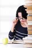Young student woman studying at the desk — Stock Photo