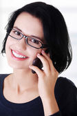 Young happy woman is calling — Stock Photo