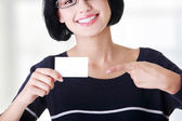 Beautiful smiling businesswoman with businesscard. — Stockfoto