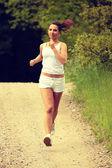 Pretty young girl runner. — Stock Photo