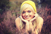 Blonde woman in heather — Stock Photo