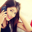 Beautiful young woman speaking by mobile phone — Stock Photo