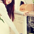 Young woman in kitchen doing housework. — Stock Photo