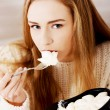 Stock Photo: Sad, depressed womeating ice creams.