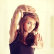 Woman making frame with her hands — Stock Photo #40194137