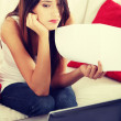 Stockfoto: Young woman's paying bills.