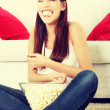 Girl watching movie — Stock Photo