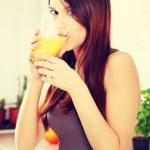 Woman drinking fresh orange juice — Stock Photo