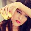 Young woman peeling potato — Stock Photo