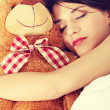 Girl in bed with teddy bear — Stock Photo #40196097