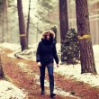 Womis walking through forest in wintertime. — Stock Photo #40199235