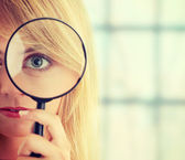 Girl with magnifier — Foto Stock