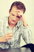 Sad man sitting with alcohol drink — Foto Stock
