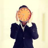 Businesswoman with clock — Stock Photo