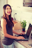 Young beautiful woman with laptop — Stock Photo