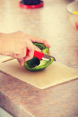 Female chopping food ingredients on the kitchen. — Stock Photo