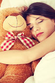 Fille dans son lit avec teddy bear — Photo