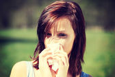 Woman with allergy wiping her runny nose — Foto Stock