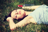 Drunk woman is sleeping on the grass. — Stock Photo