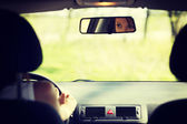 Face of woman driving the car — Stock Photo