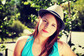Young beatiful woman in summer hat. — Stock Photo