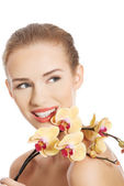Woman with orchid flower. — Stock Photo