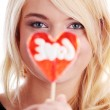 Teenage girl holding red lollipop — Stock Photo #40461621