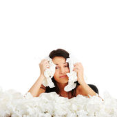 Young woman in lot of tissues around — Stock Photo
