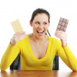 Stock Photo: Eating dark and white chocolate