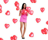 Beautiful young woman with red heart balloon — Stock Photo