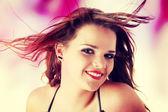 Mujer con el viento en el pelo — Foto de Stock