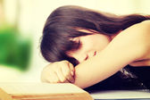 Woman sleeping on desk — Foto Stock