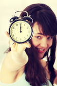 Chica con reloj despertador — Foto de Stock
