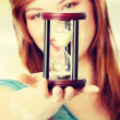 Woman holding hourglass — Stock Photo