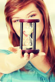 Woman holding hourglass — Stock Photo