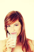 Teen woman drinking milk — Stok fotoğraf