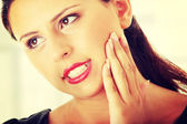 Young woman is having toothache — Stock Photo