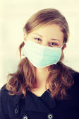 "A model wearing a mask to prevent ""Swine Flu"" infection. — Stock Photo"