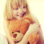 Kid embraces teddy bear — Stock Photo
