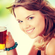 Young womin bikini drinking ice tea — Stock Photo #41073513