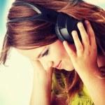 Beautiful teenage girl listening to music — Stock Photo #41073771