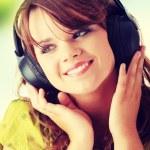 Beautiful teenage girl listening to music — Stock Photo #41073837