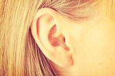 Closeup picture of blond girl ear — Stock Photo