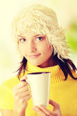 Winter girl with hot cup — Stock Photo