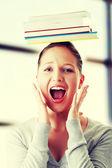 Student with books on head — Zdjęcie stockowe