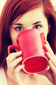 Beautiful lady is drinking coffee — Stock Photo