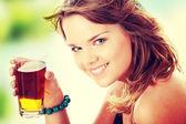 Young woman in bikini drinking ice tea — Stock Photo