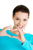 Woman showing heart gesture — Stock Photo