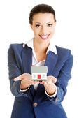 Businesswoman holding house model — Photo